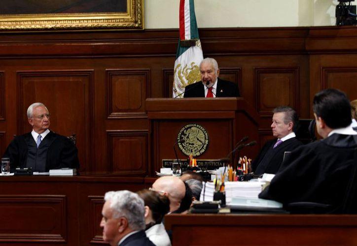 Luna Ramos (c) manifestó que el Tepjf mantiene una política internacional sustentada en el fortalecimiento de la función jurisdiccional y en la expansión de los valores democráticos. (Notimex/Archivo)