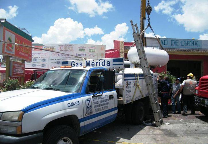 Una fuga en las instalaciones de gas L.P., que se combinó con una chispa, fue la causa de la explosión en La Nao de China. (José Acosta/SIPSE)