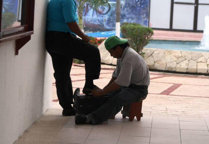 La principal característica de un trabajador informal, es que no cuenta con acceso a ningún beneficio de seguridad social. (Octavio Martínez/SIPSE)