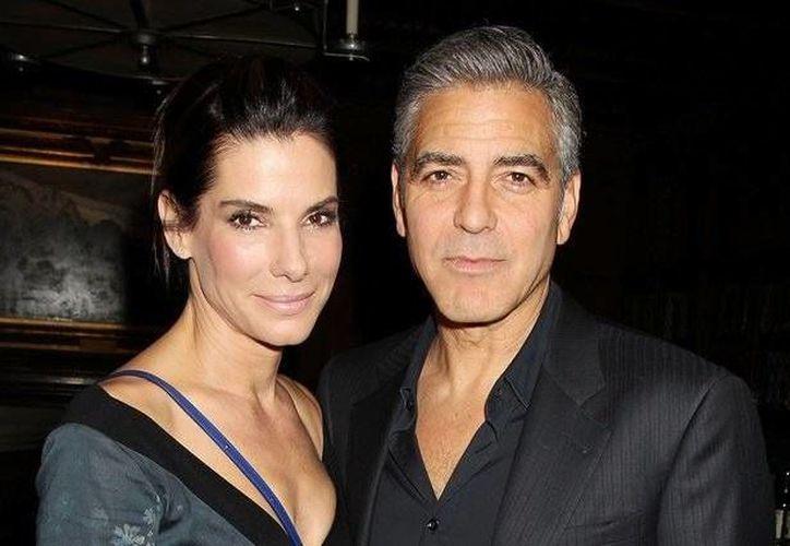 Sandra Bullock y George Clooney en un almuerzo en honor a la película 'Gravity', ofrecido por The Peggy Siegal Company y Warner Brothers Pictures, el miércoles 2 de octubre, en Nueva York. (Agencias)