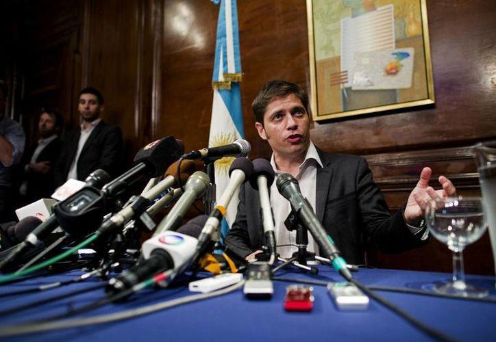 """""""Que se queden tranquilos los argentinos. Mañana será otro día y el mundo seguirá andando"""", indicó el ministro de Economía Axel Kicillof, en rueda de prensa en Nueva York. (Foto: AP)"""