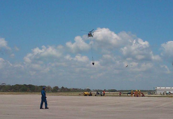 El estado no tendrá que erogar en el alquiler de helicópteros para controlar posibles conflagraciones. (Harold Alcocer/SIPSE)
