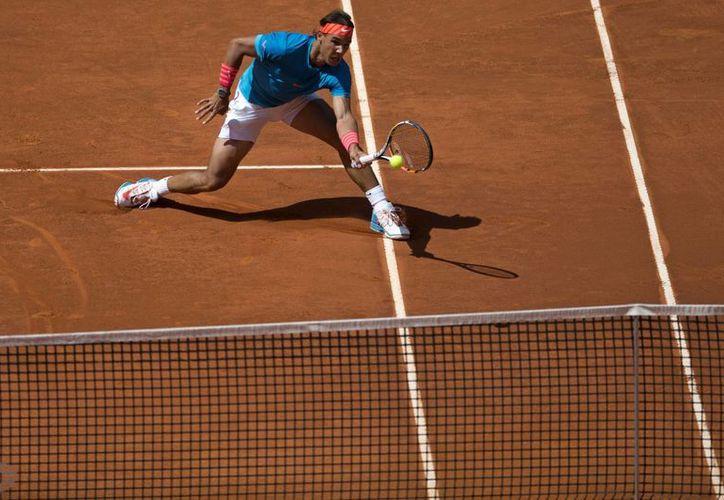 Rafael Nadal se impuso a Grigor Dimitrov y ahora se verá las caras con Tomas Berdych en una de las semifinales del Abierto de Madrid. (Foto: AP)