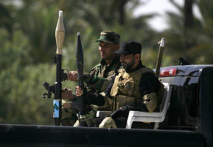 Soldados de la milicia chií, de las brigadas de Hezbolah. (Archivo/EFE)