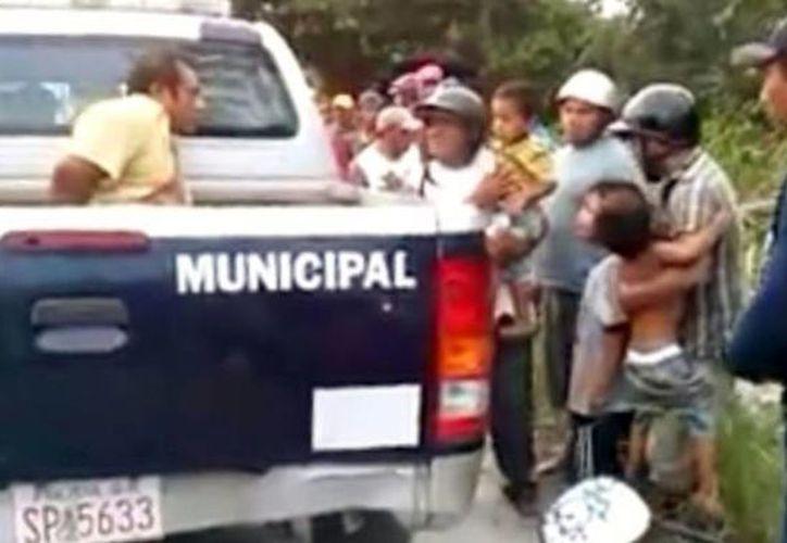 Anjelo fue detenido violentamente en agosto cuando realizaba su labor de campesino. En la imagen el momento del arresto. (Redacción/SIPSE)