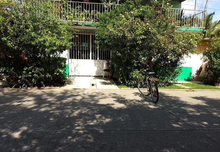 Dentro de la casa se encontraba a la mujer en el suelo. (Facebook: Denuncia Ciudadana Martínez De La Torre Ver.)