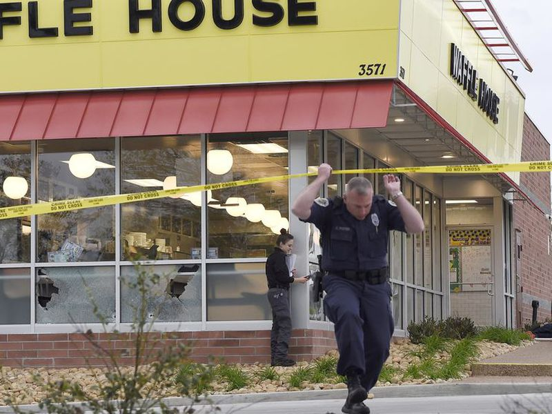 Metro Nashville Police investigate the scene at an Antioch Waffle House where at least four people died after a gunman opened fire early. (AP).