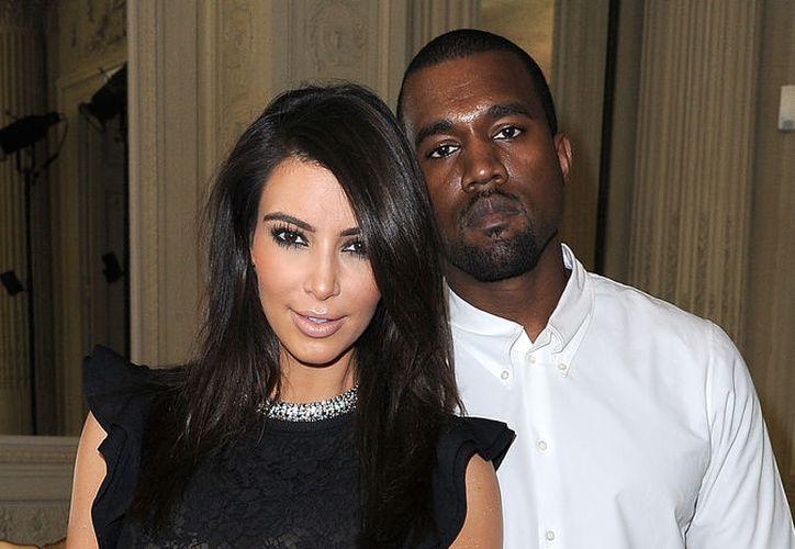 Por Navidad, el rapero decidió regalarle a su mujer Kim Kardashian un generoso paquete de acciones de empresas. (Foto:  Life & Style)