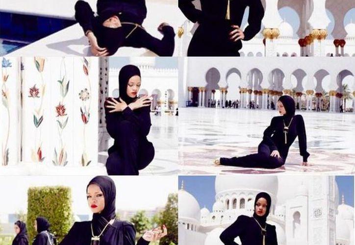 """La cantante posó cubierta con un pañuelo y ataviada con un """"overall"""" (mono) negro y un llamativo colgante en la mezquita Sheish Said. (twitter.com/Alvarorevi)"""