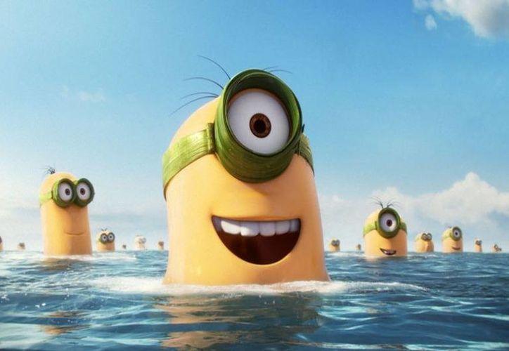 """Imagen sin fecha distribuida por Universal Pictures donde se ven varios """"minions"""", en una escena de la película animada """"Minions"""". (Illumination Entertainment/Universal Pictures via AP)"""
