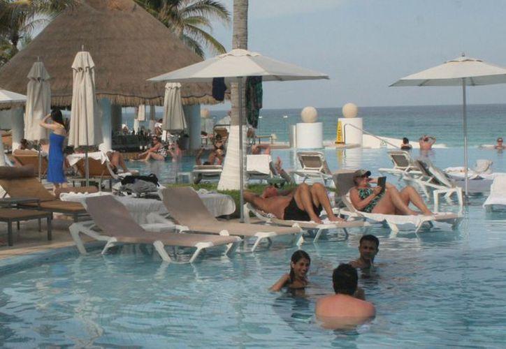 Cancún y la Riviera Maya cuentan con la infraestructura turística necesaria para albergar el evento en el 2014. (Jesús Tijerina/SIPSE)