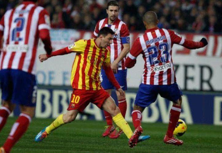 Lionel Messi definió a su equipo favorito para la Champions League, la cual se jugará entre los monstruos madrileños: Atlético y Real. (Archivo/ AP)