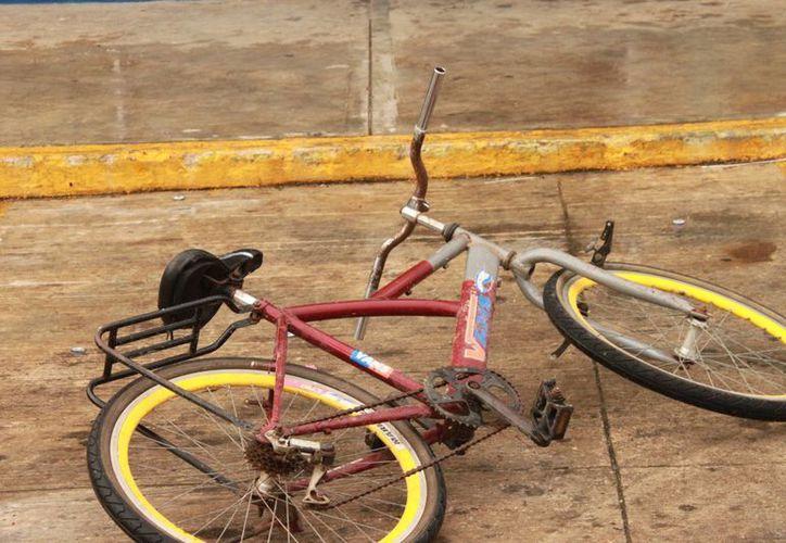 El delincuente dejó tirada la bicicleta y se introdujo en un depósito de cervezas. (Archivo/SIPSE)