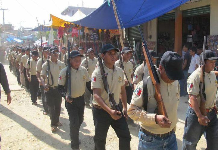 Miembros de la Policía Ciudadana y Popular para la autodefensa de los pueblos nahuas en Temalacatzingo, Guerrero.  (Notimex)