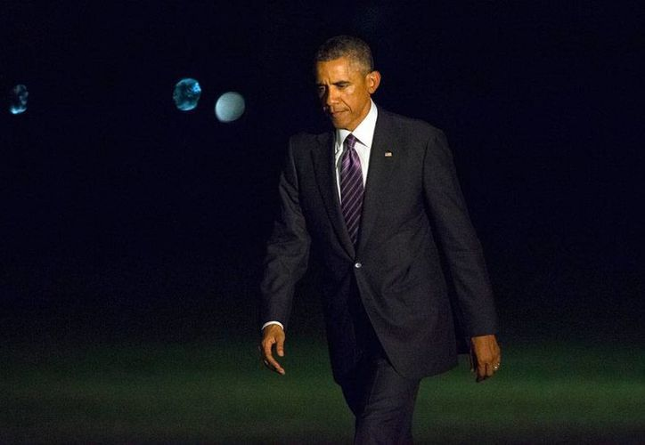 El Servicio Secreto está en alerta máxima ante las amenazas de muerte contra el presidente Barack Obama. En la imagen, el mandatario llega a la Casa Blanca, luego de un viaje a Nueva York. (AP)