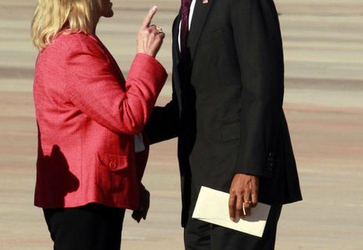 Brewer y Obama han discrepado en el tema de migración. (Agencias)