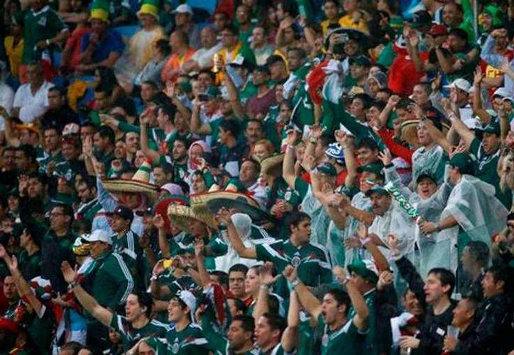Afición mexicana en el partido de México contra Brasil (Milenio).