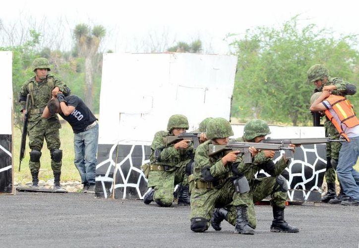 Se ha observado un descenso del 50% de quejas en contra de elementos de las fuerzas armadas. (Notimex)
