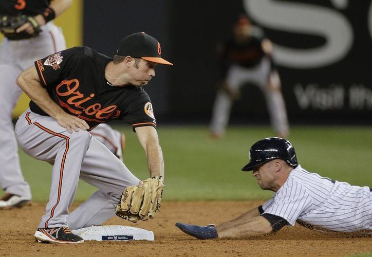 Brett Gardner, de Yanquis, se roba la segunda base frente a Orioles. (Foto: AP)