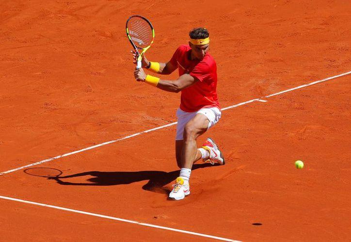 Rafael Nadal afirmó que no está libre de dolencias y seguro de regresar a las canchas. (Reuters)