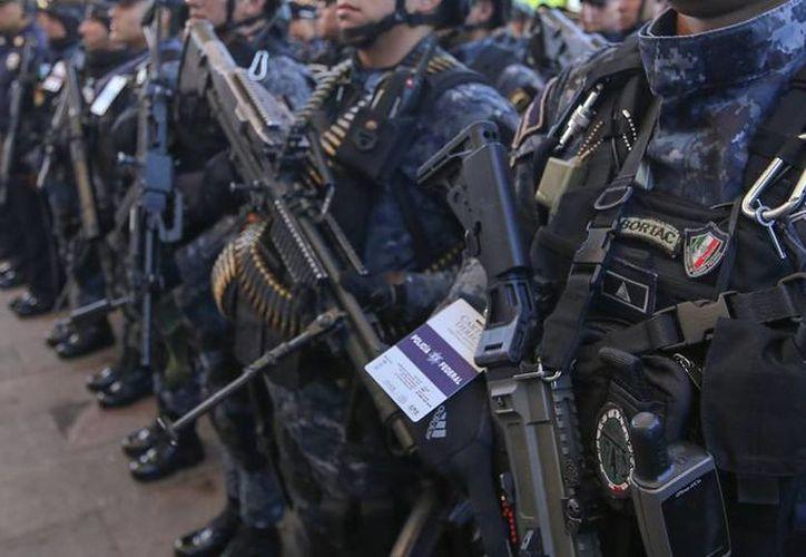 Como parte del Fondo de Aportaciones para la Seguridad Pública (FASP), Yucatán recibirá más de 178 mdp para ejercer en 2016. La imagen, de elementos de la Gendarmería Nacional, está utilizada sólo como contexto. (Archivo/NTX)