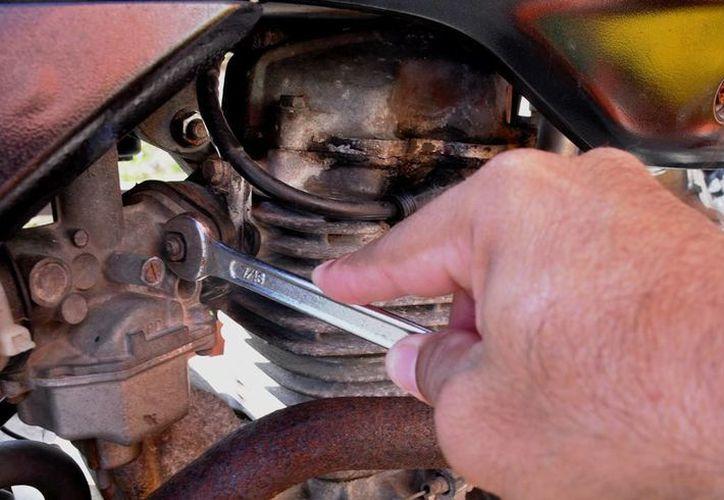 Invitan al taller de reparación de motos. (Cortesía/SIPSE)