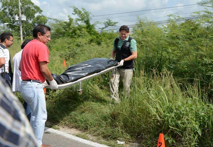 Una vez identificado el cadáver de Miguel Angel Mex Hernández, Ronquito, de Hunucmá, a un lado de la vía Ucú-Caucel, sus parientes interpusieron una denuncia por homicidio. (SIPSE)