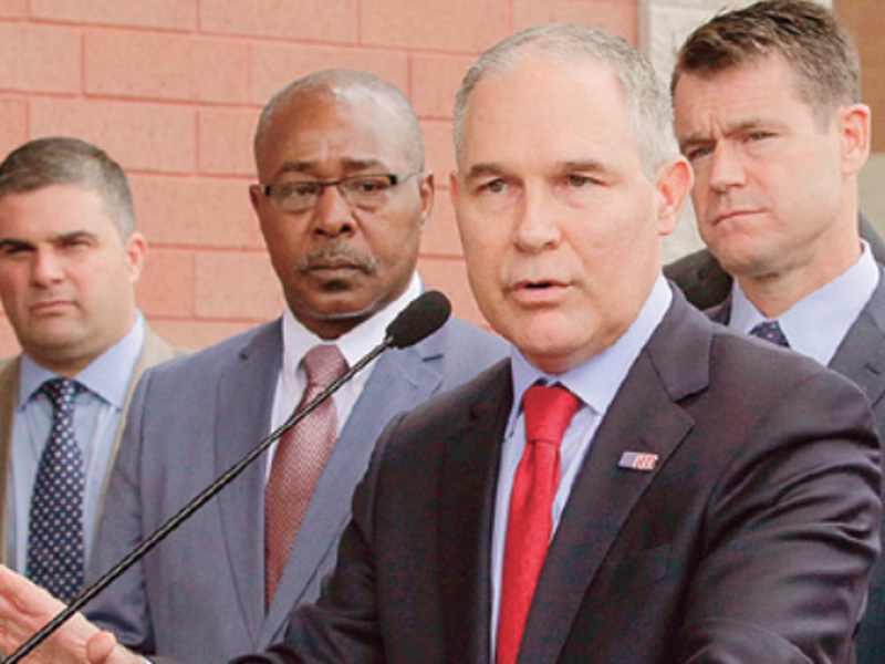 """Environmental Protection Agency Administrator Scott Pruitt speaks at a news conference with Pasquale """"Nino"""" Perrotta, second from left, in East Chicago, Ind. (AP)"""