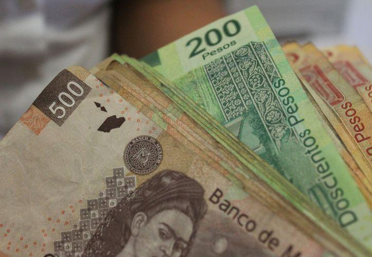 Alertan a comerciantes por la circulación de billetes falsos en Playa del Carmen. (Foto: Daniel Pacheco/SIPSE)
