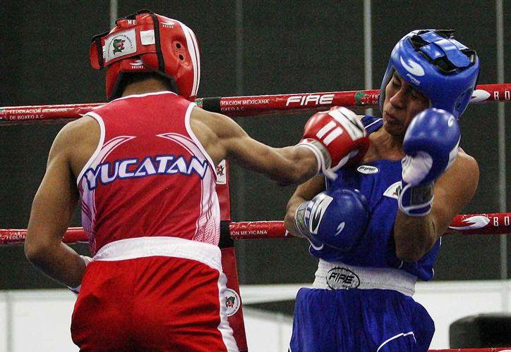 Carlos Castro Núñez, coordinador de boxeo del Instituto del Deporte de Yucatán (IDEY), cree que 2016 será mucho mejor, ya que no han descansado tras su regreso de la Olimpíada Nacional. (SIPSE)