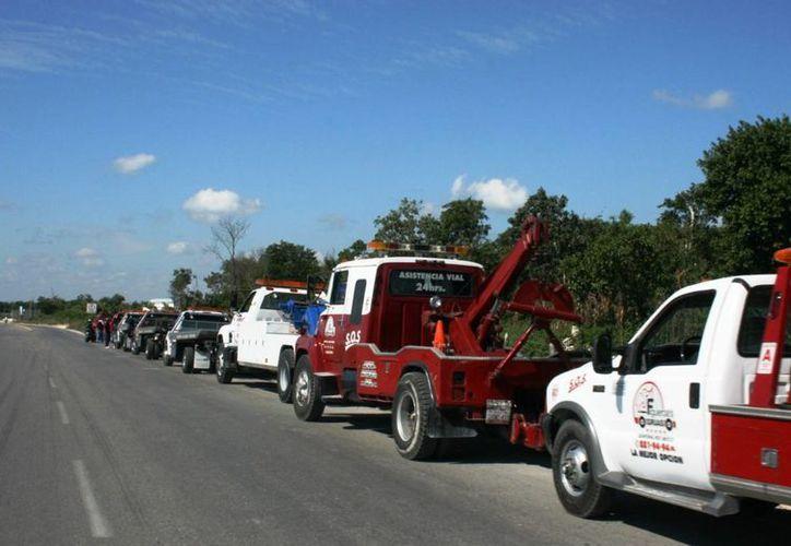 Las grúas y los corralones se encuentran nuevamente bajo la mira de las autoridades; pretenden regularlos. (Daniel Pacheco/SIPSE)