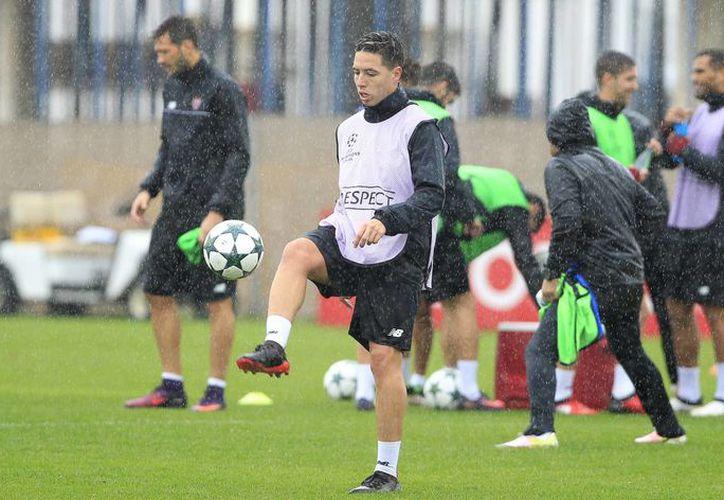 Al Sevilla (foto de un entrenamiento) le basta empatar ante Juventus este martes para calificar a octavos de final de la Champions League. (AP)