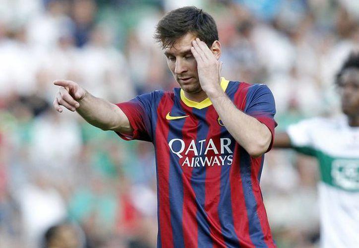 El delantero argentino del Barcelona Lionel Messi tras desperdiciar una oportunidad de gol ante el Elche. (AP)