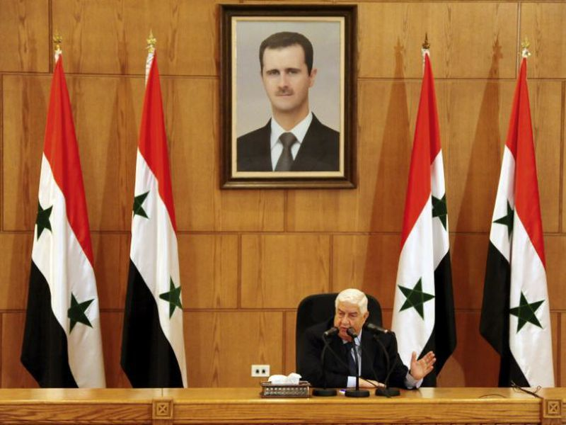 Al-Moallem said Iranian military advisers are embedded with Syrian troops but Tehran has no combat forces or fixed bases in the country. (AP)