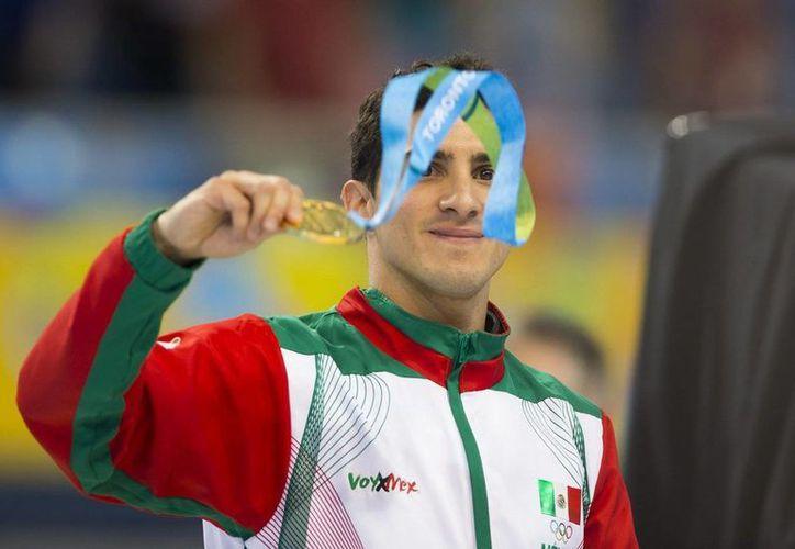 Rommel Pacheco participará en el trampolín de 3 metros de manera individual y sincronizada.(Milenio)