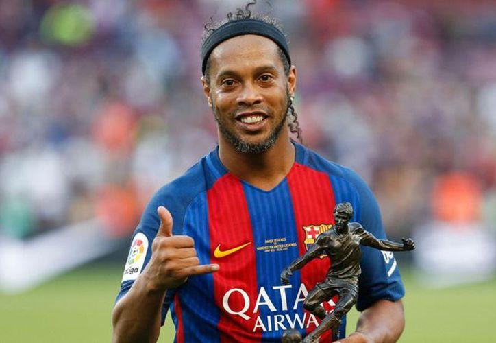 El último club profesional en el que Ronaldinho jugó fue el Fluminense F.C. de Brasil. (Contexto)