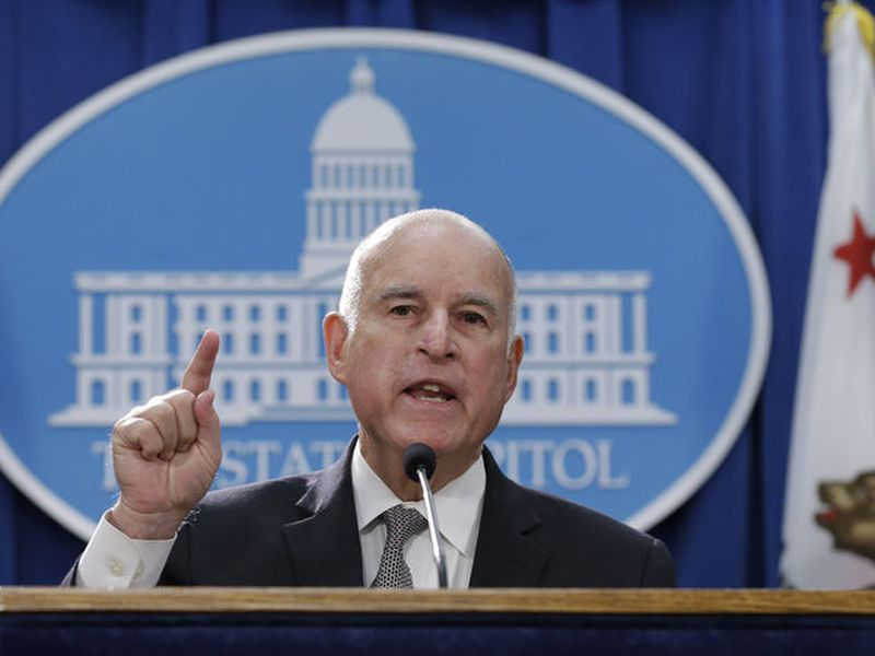 Gov. Jerry Brown discusses a lawsuit filed by 17 states and the District of Columbia over the Trump administration's plans to scrap vehicle emission standards during a news conference, in Sacramento, Calif.
