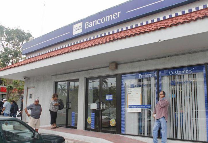 Los bancos reabrirán el próximo 2 de enero. (Jesús Tijerina/SIPSE)