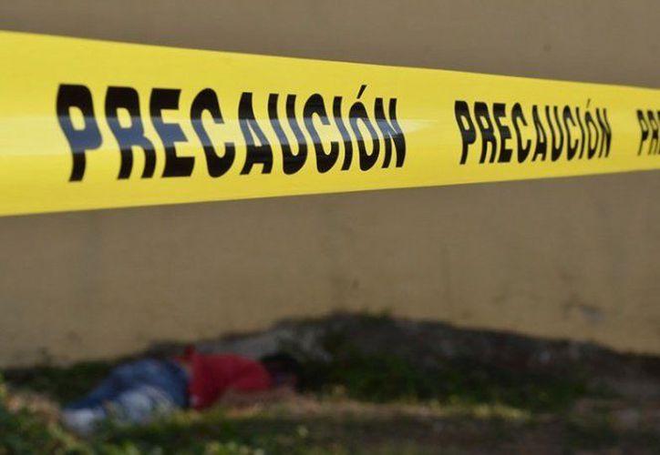 Hombre armados arribaron al festejo y mataron a las personas en la comunidad de San Juan Lachigalla. (Foto: Twitter)