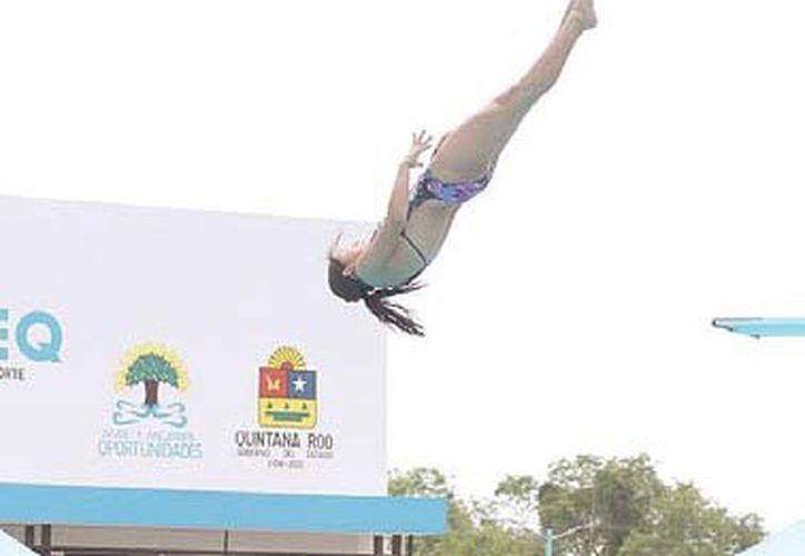 Deportistas infantiles de Mérida, Cancún y Chetumal participaron en la Copa Quintana Roo de Clavados este fin de semana. (Miguel Maldonado/SIPSE)