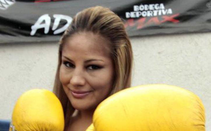 Mariana Juárez espera que la imagen más fresca y cálida que ofrecerá en el almanaque le permita romper con la imagen fuerte de boxeadora. (Archivo Notimex)