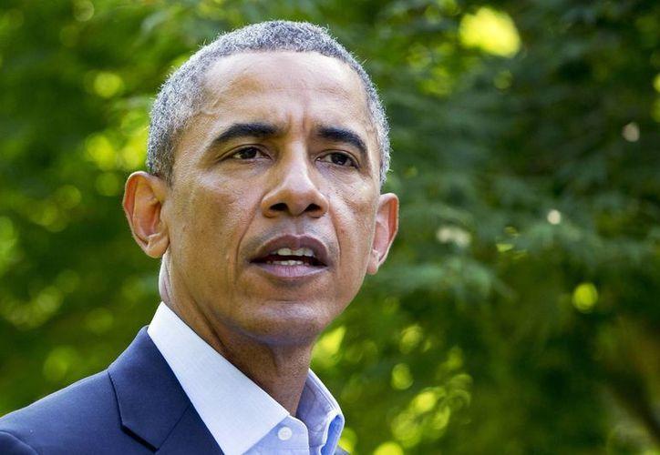 Obama llamó a los habitantes de Fergusonm, Missouri, a tranquilizarse tras los disturbios registrados por el asesinato del joven afroamericano Michael Brown. (AP)