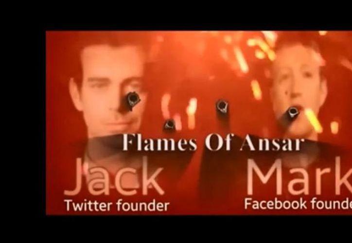 En el video los piratas cibernéticos del grupo extremista colocan fotografías de los rostros de Zuckerberg y Dorsey envueltas en llamas y con agujeros de bala. (Captura de pantalla YouTube)