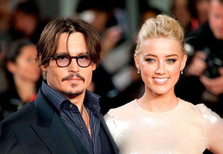 Johnny Depp y Amber Heard se conocieron en 2011 durante la filmación de la película 'The Rum Diary'; se casarán la próxima semana. (usmagazine.com)