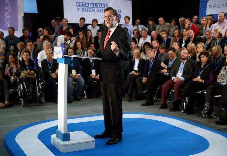 El presidente del Gobierno y líder del PP, Mariano Rajoy, durante su intervención en la clausura de las jornadas sobre el gobierno en los ayuntamientos organizadas por el PP en Barcelona en noviembre pasado. (EFE)