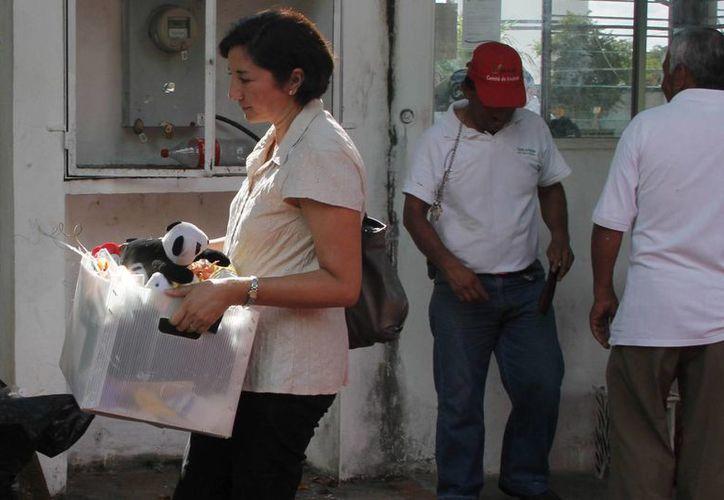 A los ex empleados les entregaban el oficio de la terminación laboral, además de solicitarles que firmen para que les entreguen su liquidación. (Harold Alcocer/SIPSE)