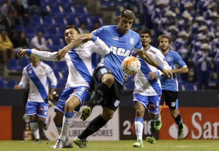 La noche de este miércoles, Puebla de México y Racing de Avellaneda de Argentina empataron a 2 dentro del repechaje en la Copa Libertadores. (Notimex)
