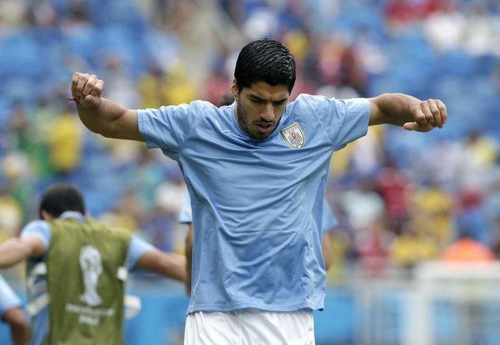 Suárez también prometió que no volverá a morder a nadie en una cancha de futbol. (EFE)