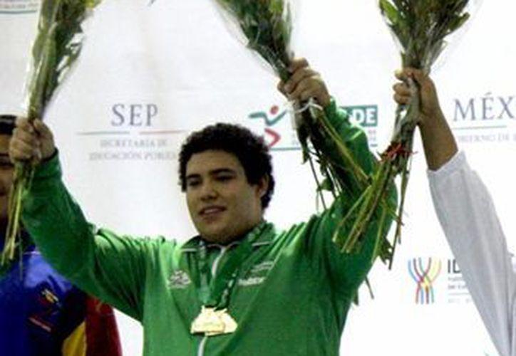 Imagen del pesista Josué Medina Azueta, quien es uno de los deportistas beneficiado con la beca CIMA. (Milenio Novedades)
