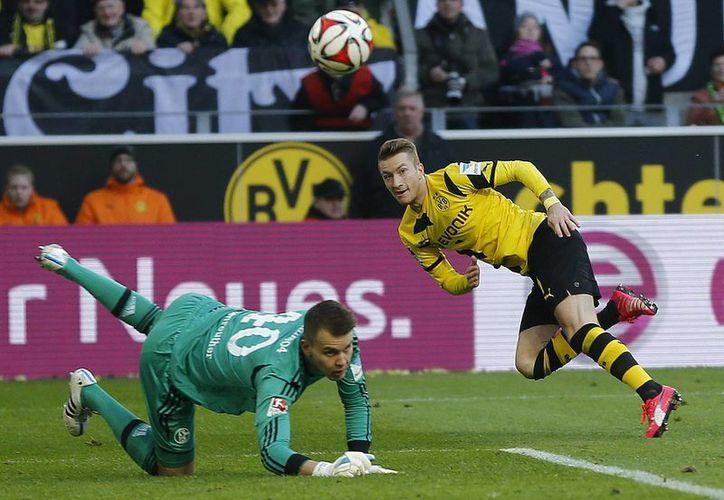 Pierre-Emerick Aubameyang, Henrikh Mkhitaryan y Marco Reus (foto) anotaron los goles por un Borussia que casi no ganaba y ahora no pierde en la Liga de Alemania. (Foto: AP)
